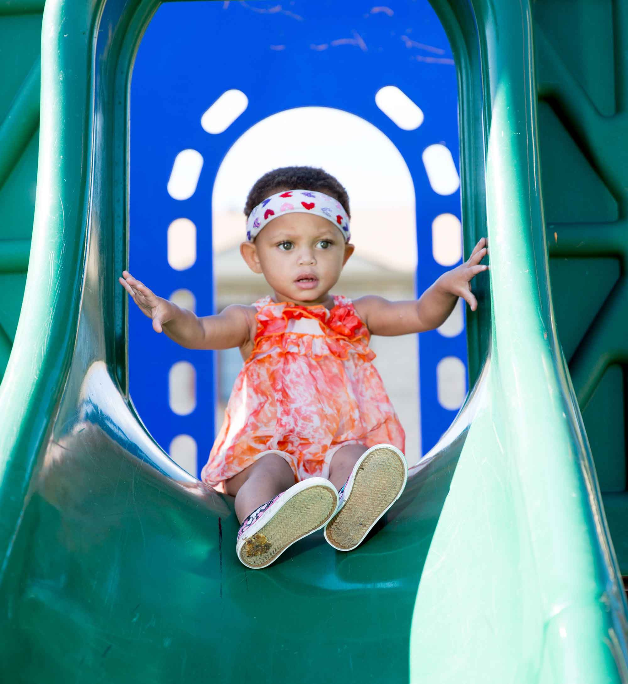 little girl on slide